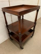 A Three tier hostess/drinks trolley on castors with turned supports (H 80 cm x 52cm w x 40cm d)