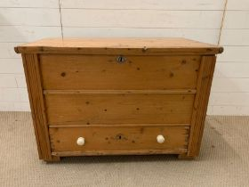 An Antique pine chest with drawer in base (99cm w x 58cm d x 67cm h)