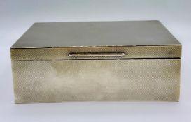 A silver cigarette box by Asprey, hallmarked for Chester 1917.