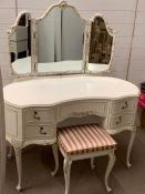 A dressing table with stool and matching floor standing mirror