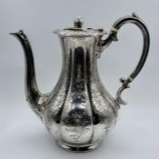 A Victorian silver coffee pot, engraved with foliate decoration and finial by Martin, Hall & Co (