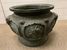 A Cast bronze Chinese planter with elephant handles, decorative panels featuring lotus leaves and