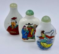 A collection of Chinese scent bottles in a wooden wall hanging display case.