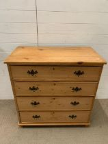 A four drawers antique pine chest of drawers (H98cm W96cm D52cm)