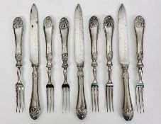 A selection of six silver handled forks and three knives