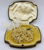 A Vintage lace butterfly brooch and a seed pearl necklace.