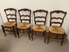A set of four French oak rush seat dining chairs