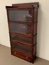 A four tier globe Wernicke mahogany barrister bookcase with glazed doors and decorative mouldings