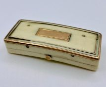 An ivory and gold patch box AF