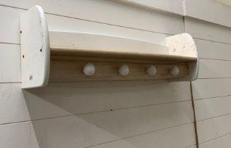 A four hook wall shelf by Pin (82 cm w x 18cm d x 26cm h)
