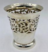 A silver vase, with pierced decoration (74g) hallmarked by William Devenport Birmingham 1902.