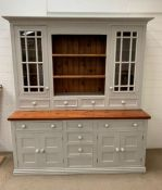 A Substantial painted Welsh Dresser with glazed cabinets, open shelves, drawers and cupboards