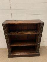 A carved oak open bookcase (H103cm W84cm D27cm)
