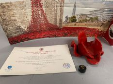 A Paul Cummins (Blood swept lands and sea of Red Ceramic poppy head with certificate (No stem)