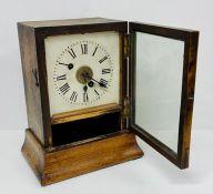 A wooden mantel clock