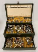A Jewellery box with a large volume of costume jewellery