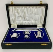 A Cased silver miniature tea set by A Chick & Sons Ltd, hallmarked for London 1975