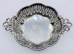 A Hallmarked silver pierced bowl with bow shaped handles, by E S Barnsley & Co (Edward Souter