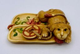 A Chinese ivory, puppy themed and signed