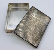 Two white metal boxes one with a playing card lid and the other a shell