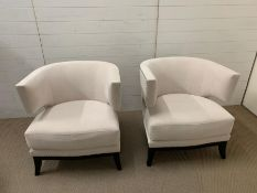 A pair of contemporary semi circular arm chairs with stud details (H80cm W75cm D80cm)