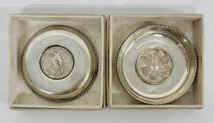 A pair of Greek silver pin dishes with inset coins