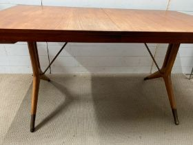 A Mid Century Swedish teak desk or dining table with brass caps and feet (H74cm W147cm D80cm) (