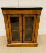 A Mahogany side cabinet with glazed doors to a single shelf, with string inlay and gilt. (60cm x