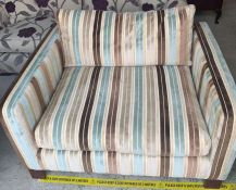A one seater sofa made by Sofawork Shop, with a hardwood frame and striped upholstery.