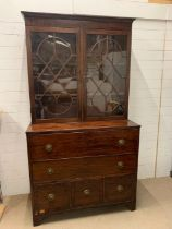 A Regency mahogany secretary bookcase, upper section with two adjustable shelves enclosed by a