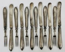 A set of six silver knives and forks (Total weight 330g) hallmarked for Sheffield 1925 by James