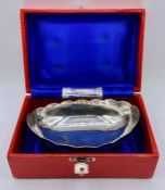 A silver bowl on four legs from Pakistan in original box.