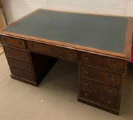 A pedestal partner's desk with leather top (H78cm W150cm D95cm)