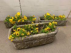Three long cast stone/concrete planters