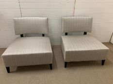 A pair of lounge/occasional contemporary chairs with square seats and curved backs (H82cm W80cm