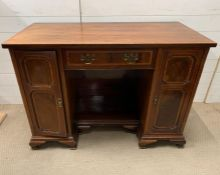 An inlaid desk with panelled front and brass handles (H82cm W115cm D55cm)