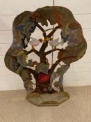 A standing art sculpture painted on a wooden base (H98cm W70cm)