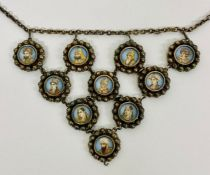 A MUGHAL necklace in white metal with ten miniature portraits.