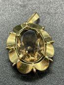 A 9ct gold pendant with smoky quartz stone. (6.6g)