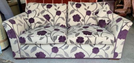 A Duresta three seater sofa, hand made in the UK with a hardwood frame and floral upholstery (W210cm