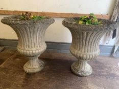 A pair of reclaimed pedestal garden urn planters (H70cm W60cm)
