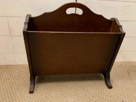 A mahogany magazine rack
