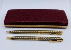 A cased set of Sheaffer 14ct gold GF (USA) pen and ball point pen set.