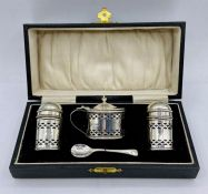 A cased cruet set with blue glass liners by John Rose, Birmingham 1931