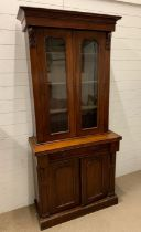 A Victorian mahogany bookcase with two panel glazed doors and two arch panelled doors to cupboard
