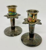 A Pair of Indian white metal candlesticks.