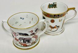 A Halcyon Dyas mug and a Royal Crown Derby 'Treasures of Childhood' mug