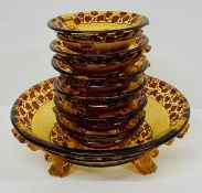 Amber and brown large glass serving bowl and six small dishes