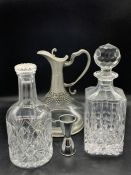 Two cut glass decanters and one port decanter with white metal work base and handle