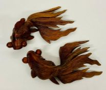 Two wooden carved fish